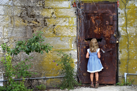 http://www.dreamstime.com/royalty-free-stock-images-behind-door-little-girl-looking-thru-hole-to-see-what-other-side-image31647979